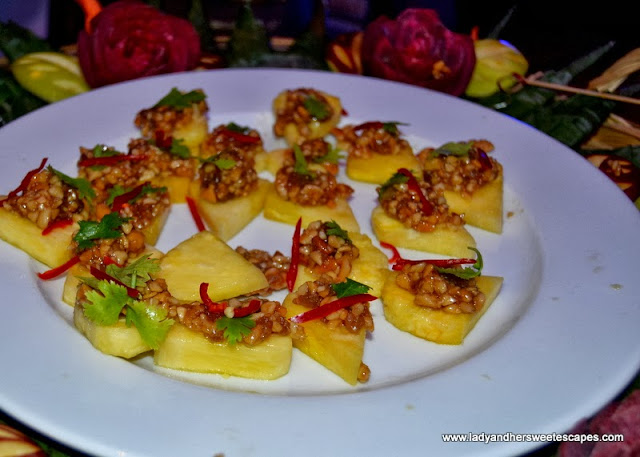 pineapple topped with peanuts and chili from The Kitchen of Thai