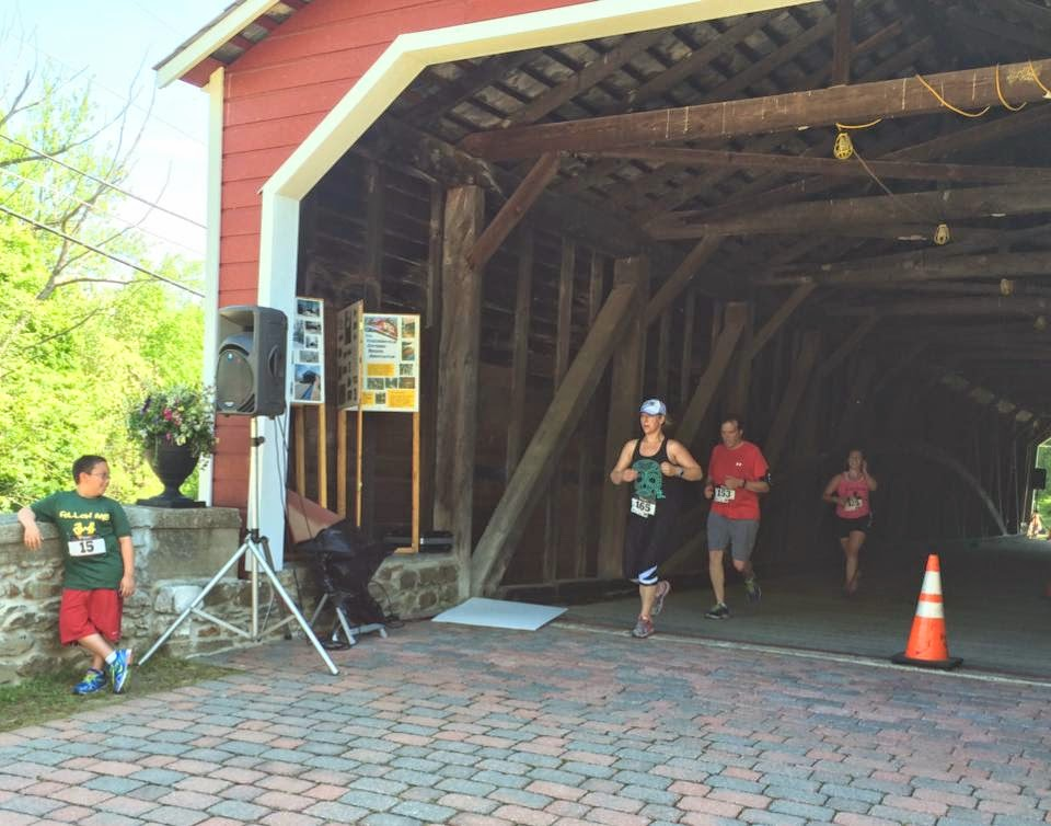 running through the covered bridge