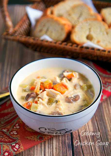 Creamy Chicken Soup Recipe - chicken, celery, carrots, mushrooms, chicken broth, cream of chicken soup, half-and-half and cheese! Can use rotisserie chicken for a super quick meal or boneless chicken breasts for an easy slow cooker meal. Freeze leftovers for a quick meal later!