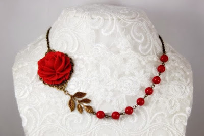 https://www.etsy.com/listing/105540488/crimson-red-rose-with-red-swarovski?ref=favs_view_1