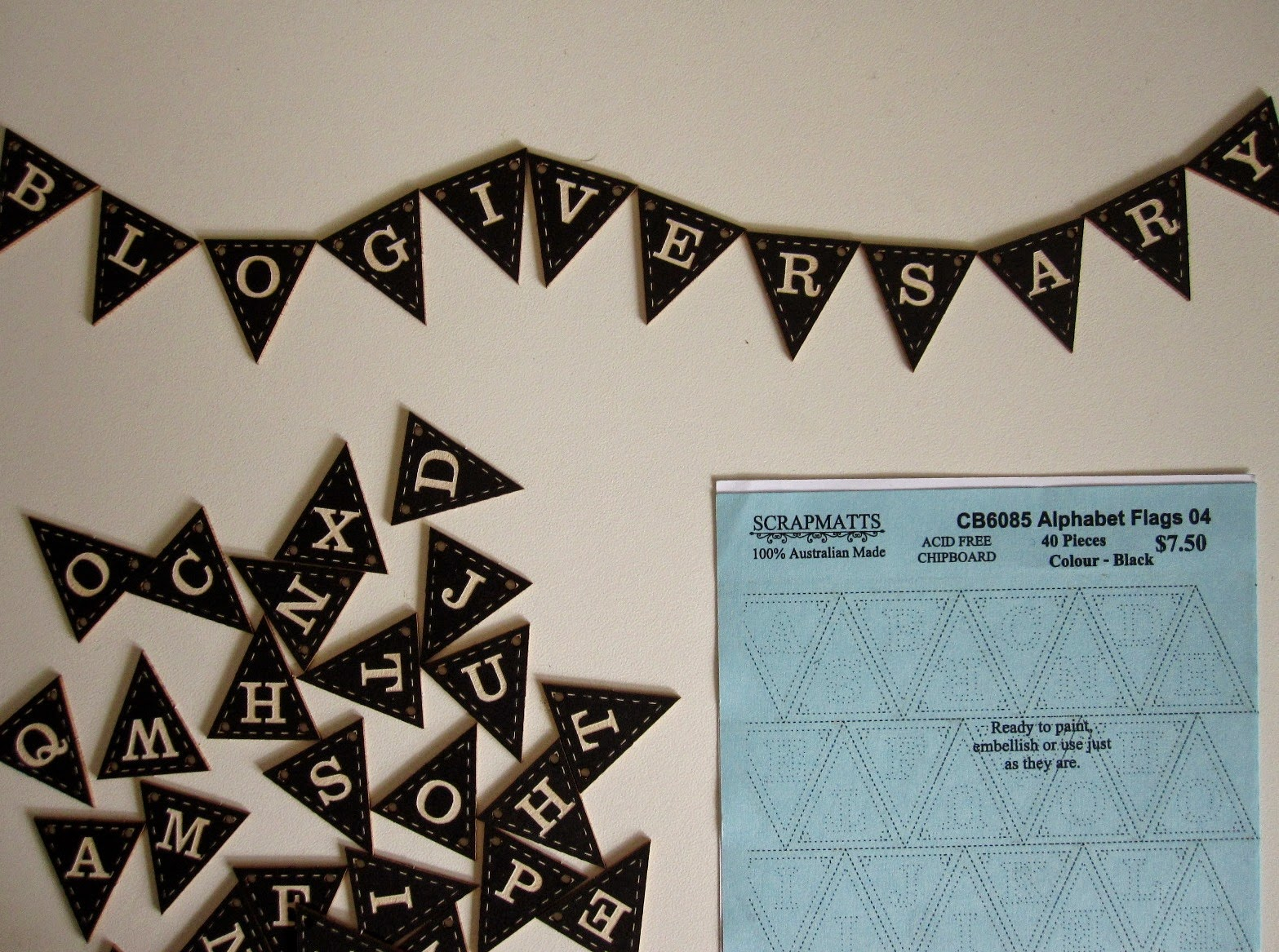 Black and white miniature bunting, spelling out the word 'blogiversary'