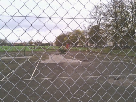 Abandoned tennis courts at Murray Park recreation ground in Ipswich, Suffolk