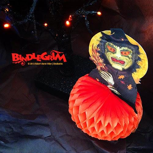 New Halloween decorations by Bindlegrim featuring green witch on orange honeycomb tissue paper base.