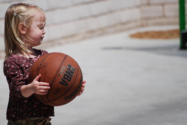Cute Girl Holding BasketBall wallpapers