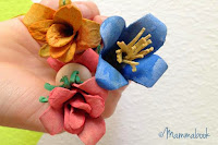 http://www.cucicucicoo.com/2015/05/tutorial-upcycle-egg-cartons-flower-fairies/