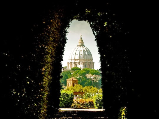 Photo of the St. Peter's Basilica Dome taken through the famous Keyhole