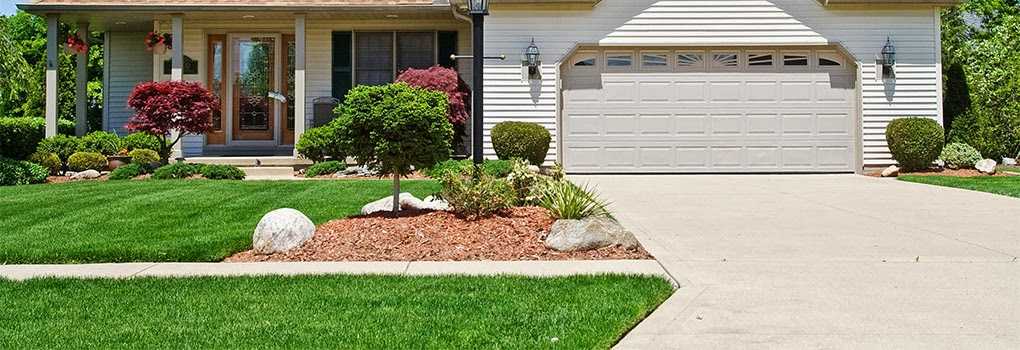 Reubens lawn care landscaping your driveway can make a for Driveway landscaping