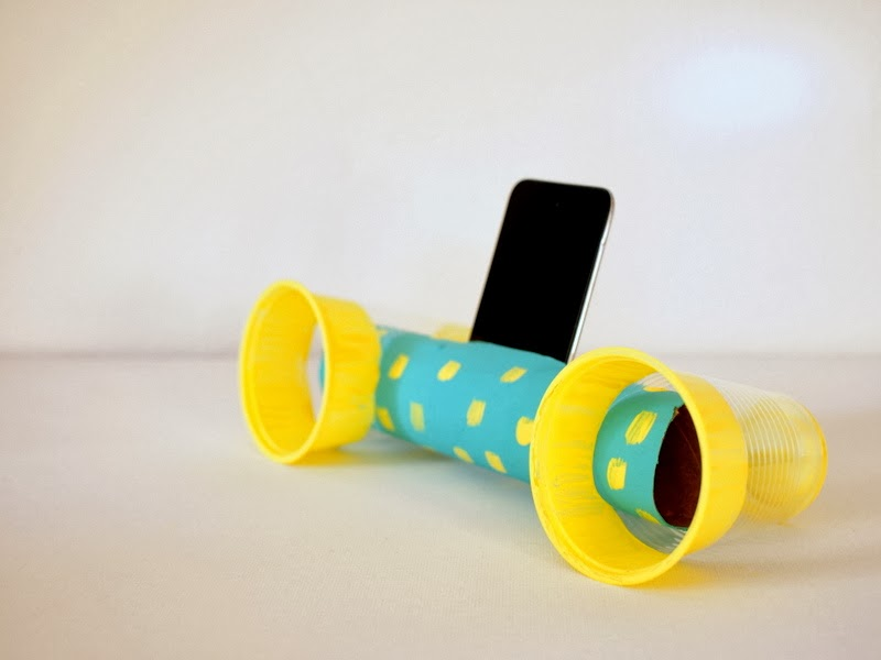 sideways view of cardboard roll and cup speakers