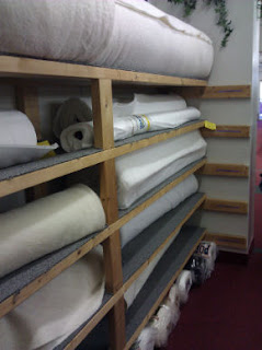 about a dozen rolls of batting materials to choose from!