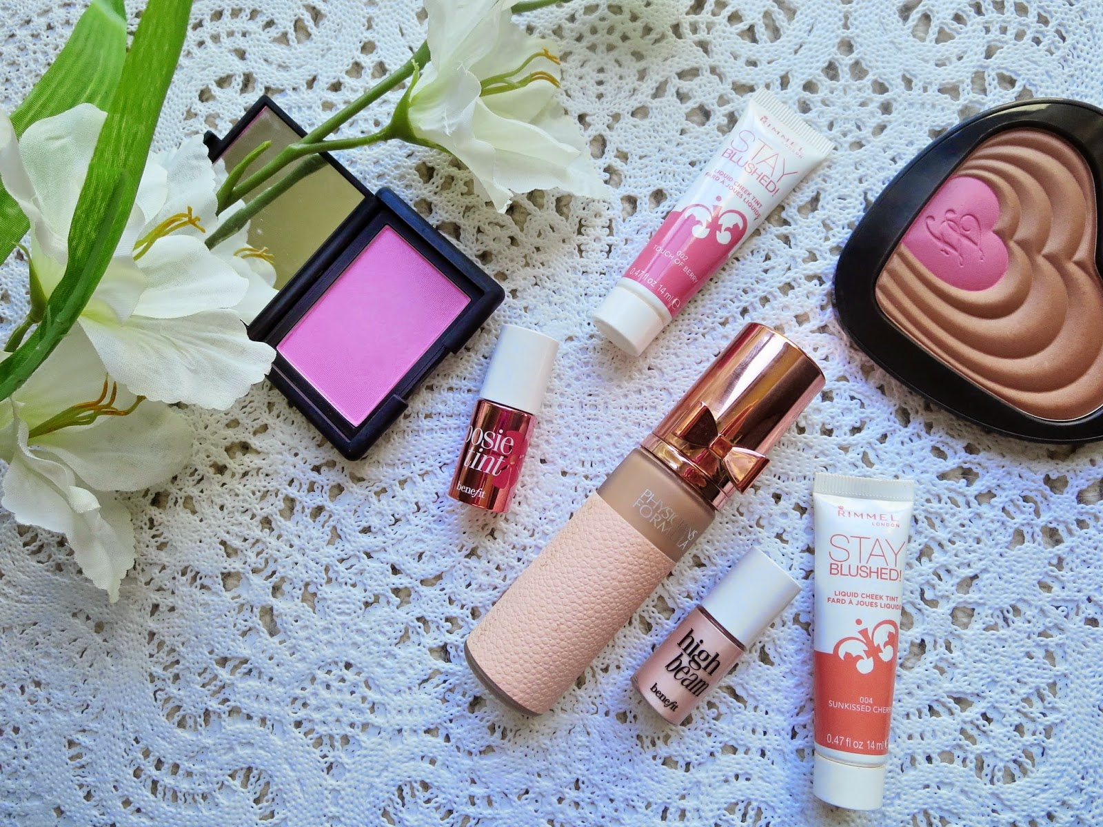 a picture of spring favorites for face ; nars gaiety, posie tint, high beam, touch of glow foundation, soul mates ross rachel, stay blushed sunkissed cherry, pop of berry