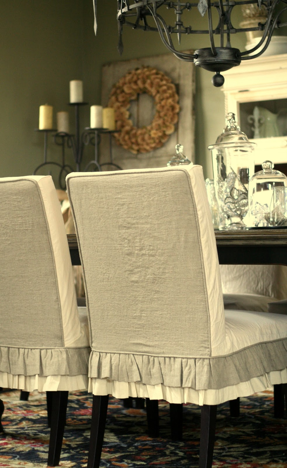 the 2 sets of tan linen curtains as the outside back of the chairs