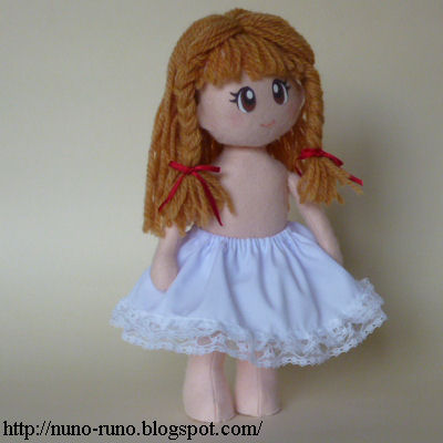 Doll puts on petticoat