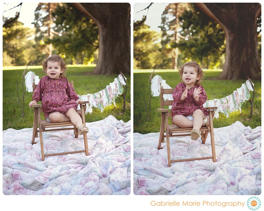 Cute little girl sitting in small wooden chair clapping and smiling.