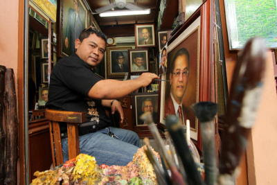 Almost lifelike: Abdul Hadi Ahmad, whose shop is at the Annex is well known for his portraits of politicians.