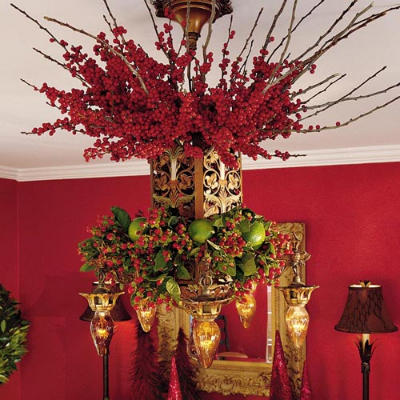 Anyone can decorate christmas chandelier diy craft this next chandelier is achieved by attaching wiring a greenery wreath to the bottom of the chandelier then wiring greenery from the top of the aloadofball Images