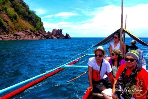 Backpackers enjoying a boat ride circling the Bellarocca island