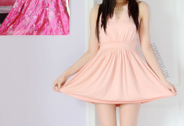 A review of this pink halterneck dress from WalkTrendy, which features unique neckline cutouts and a golden chain necklace detail.
