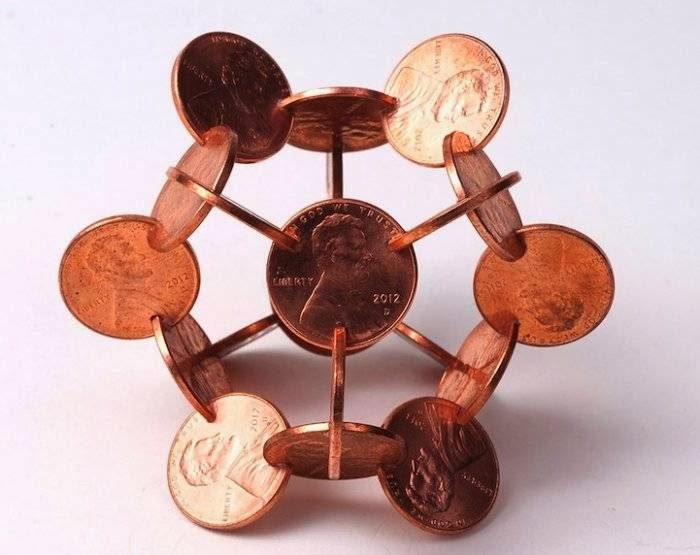 These coin sculptures by Robert Wechsler were commissioned by The New Yorker for their October 14th, 2013 money edition of the magazine.  Wechsler intricately cut notches into common coins using a jeweler's saw to create complex geometric forms and shapes.