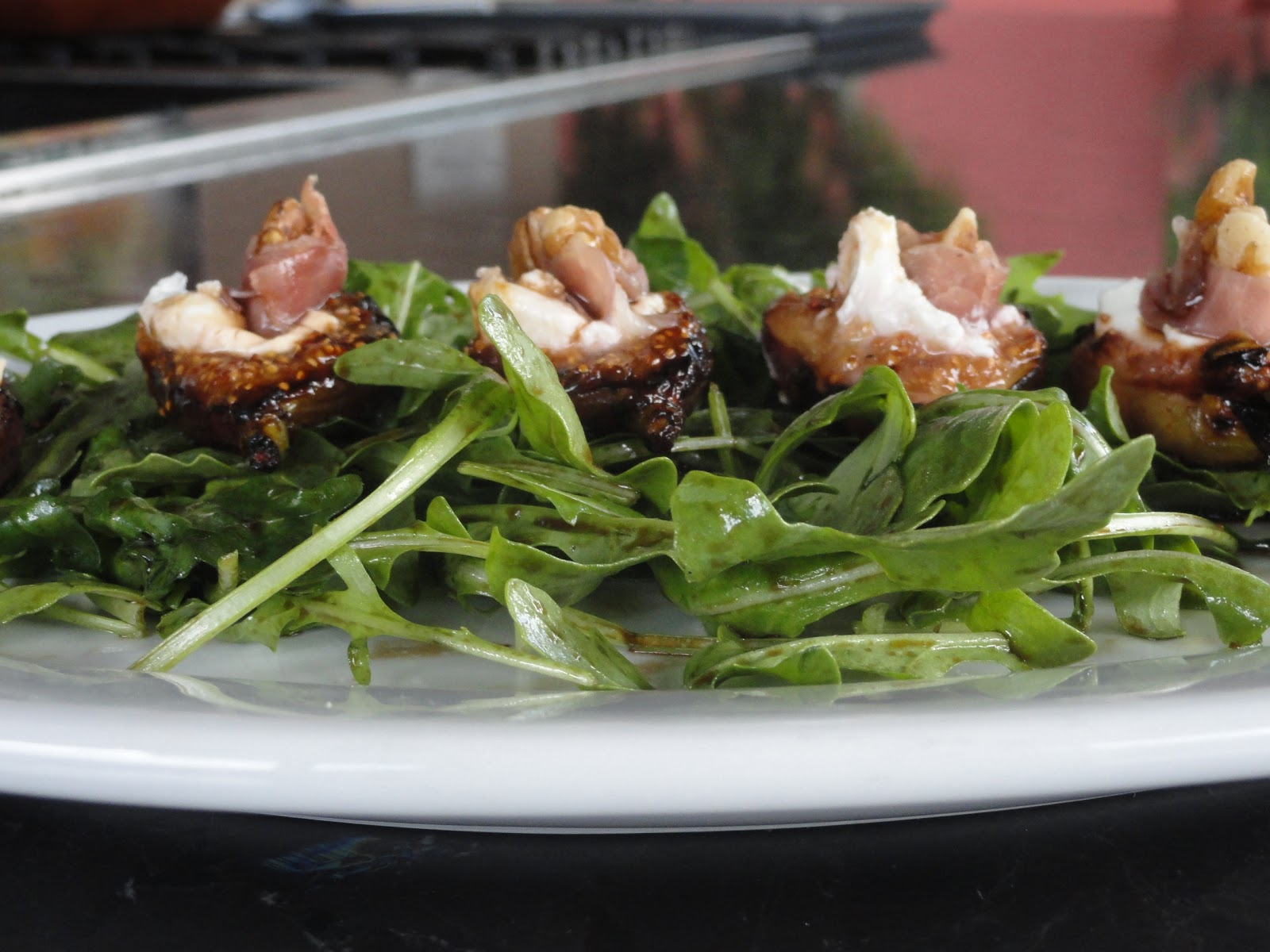 Next shegrilled the figs and stuffed them with goat cheese, walnuts ...