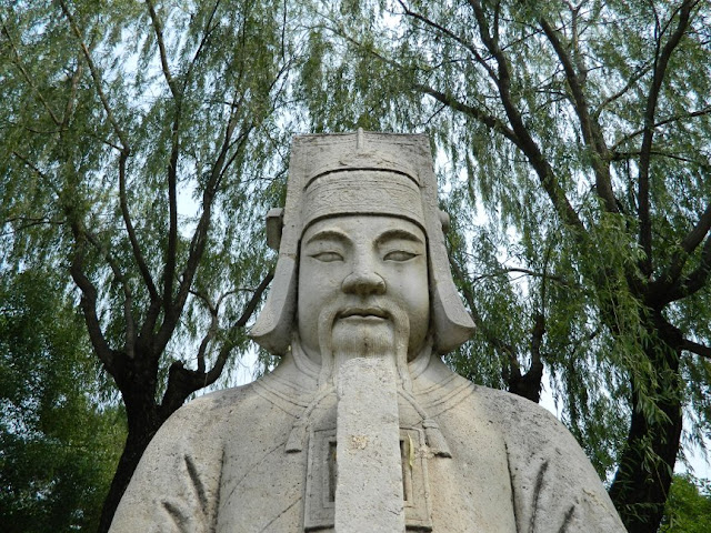 Ming Tombs statue with willows along Sacred Way path by garden muses: a Toronto gardening blog