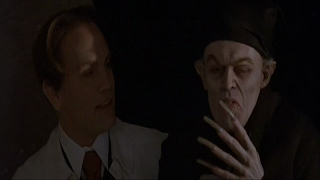 John Malkovich as F. W. Murnau and Willem Dafoe as Count Orlok, Shadow of the Vampire
