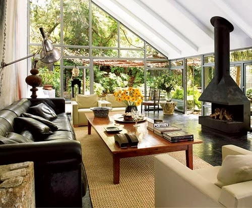 Beautiful abodes sunrooms equally lovely spaces part of for Sunroom with fireplace