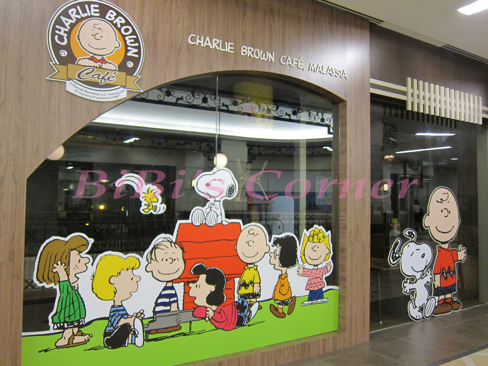 newly opened charlie brown cafe at straits quay its interior decoration has everything from lights table tops to wallpapers and most importantly they
