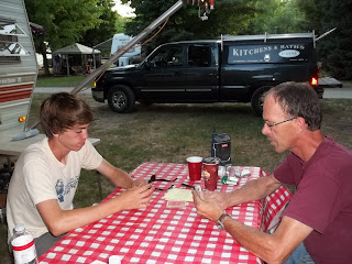Jim and Nick enjoy a quiet game of Gin at Spruce Row Campground
