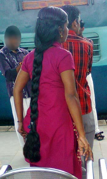 Kerala college girl in long hair braid style.