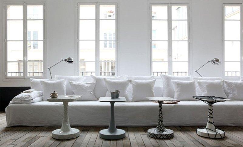 Parisian Apartment with modern white sofa and white stone wall