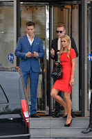 Paris Hilton leggy in a bright orange dress