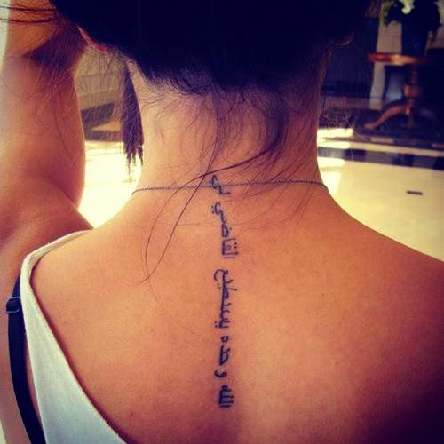 cool arabic spine tattoo design