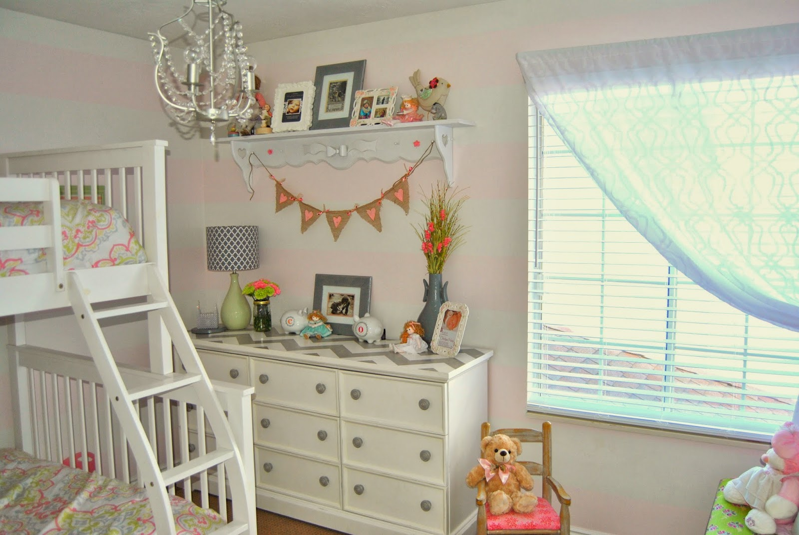 pink, gray, horizontal stripes, stripes, paint, graphic prints, girly, bunkbed, bunk bed, white bunk bed, stencil, lamp, medallion print, medallion, pink, watermelon, green, stacked pillows, bedroom, little girl, little girls room, shared room, floating shelf, shelf, chandelier, ikea, homegoods, chevron, dresser, white dresser, diy, sheer curtain, toy box, window seat, interior design, interiors, studio 7 interior desgin, blogger, blogging, designer, design, airy, fresh, target, hobby lobby, tjmaxx, ross, marshalls