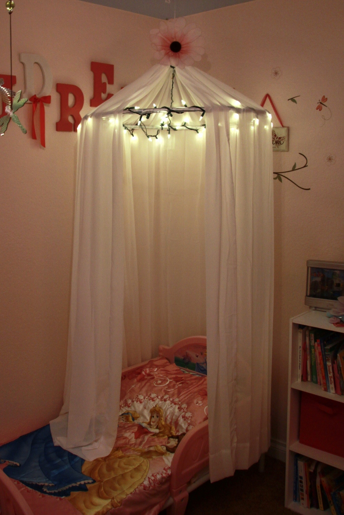I think this was my very first Pinterest project   I made this Nov 2011 for  my 2 year old daughter  I had 2 boys first so my poor daughter is just  consumed. Adventures in Pinteresting  Little Girls Bed Canopy with Lights
