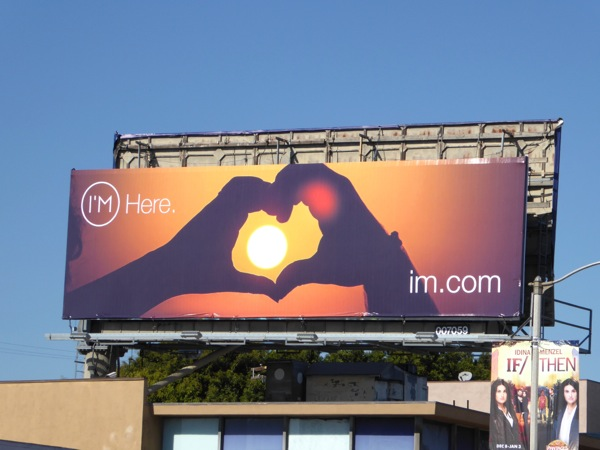 I'm Here hand heart sun billboard