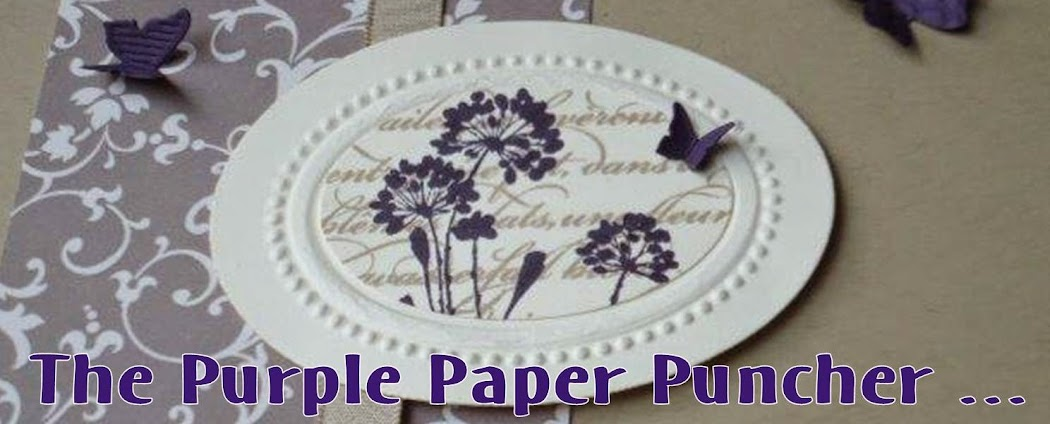 The purple paper puncher