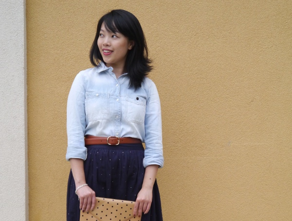 Vancouver blogger Lisa Wong of Solo Lisa wears a Madewell chambray shirt and cognac leather booties, J. Crew cognac leather belt and polka dot invitation clutch, Chinti and Parker skirt from Vancouver boutique Oliver and Lilly's, and a silver charm bracelet from Birks.