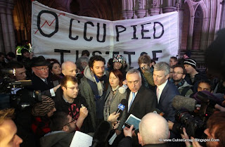 Occupy London protesters, with John Cooper QC, blue tie, and barrister Michael Paget, pink tie, at the High Court following news that the City of London Corporation has won its High Court bid to evict anti-capitalist protesters from outside St Paul's Cathedral.