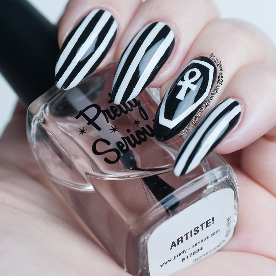 Halloween nail art with a coffin, ankh and striped design. Pretty Serious Artiste top coat.