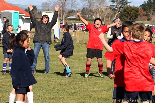 Centre right: Jehoshua Monegro, Ongaonga School, celebrating his team's win - junior soccer vs St Joseph's School, Waipukurau - Ongaonga Sevens Tournament at Ongaonga, Central Hawke's Bay. photograph