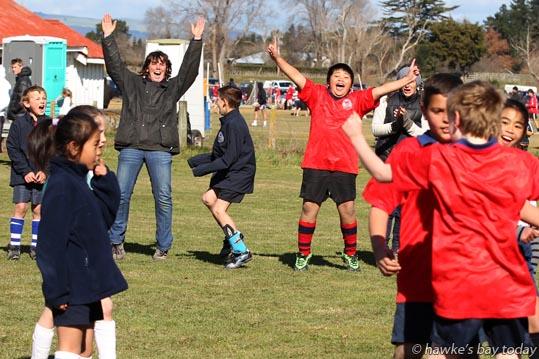 Centre right: Jehoshua Monegro, Ongaonga School, celebrating his team's win - junior soccer vs St Joseph's School, Waipukurau - Ongaonga Sevens Tournament at Ongaonga, Central Hawke's Bay. photograph
