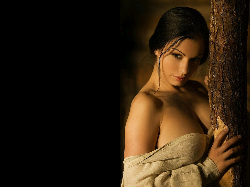 Beautiful lady with beautiful breasts playing guitar hero 8