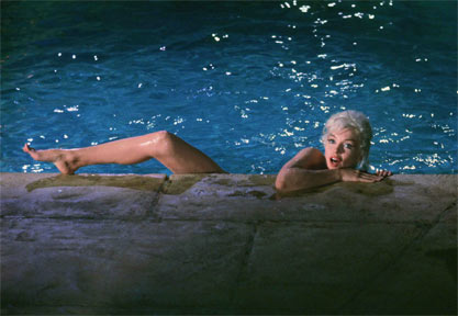 Marilyn Monroe by Lawrence Schiller, Marilyn swimming in a blue pool