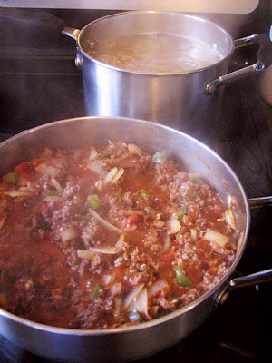 sauce and pasta simmering