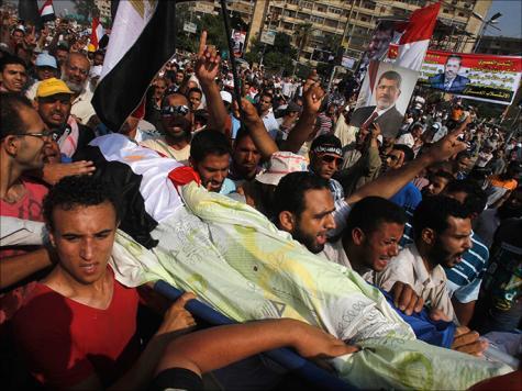 Polisi Tembakkan Gas Air Mata pada Demonstrasi Pendukung Mursi