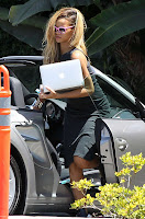 Rihanna carrying a laptop