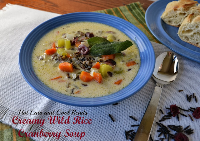 This is a perfect cooler weather soup! The cranberries add a great burst of flavor and Minnesota wild rice is the star! Creamy Wild Rice Cranberry Soup Recipe from Hot Eats and Cool Reads!