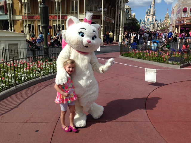 Happy Child with Kitty at Magic Kingdom