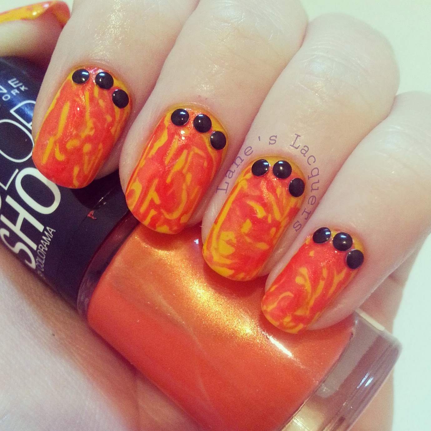 january-tri-polish-red-orange-yellow-dry-marble-nails