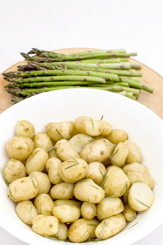 Asparagus and young potatoe close